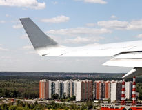 View from airplane. Of the wing and a city beneath Royalty Free Stock Photography