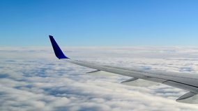 View from an airplane above the clouds stock video