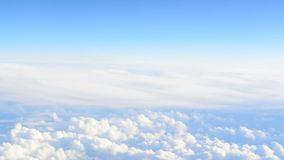 View from an airplane above the clouds stock footage