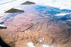 View from airplane above clouds royalty free stock photos