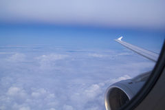 View from an airplane above clouds Stock Photography
