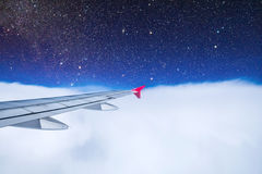 View airplane with cloudy blue stratosphere stars. View airplane with cloudy blue stratosphere and stars Stock Photo
