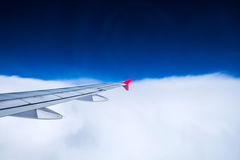 View airplane cloudy in sky Stock Image
