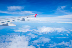 View airplane cloudy in sky Stock Photography