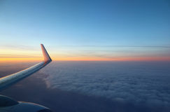 The view from an airplane in flight at the sky and clouds Stock Image