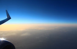 The view from an airplane in flight at the sky and the earth Royalty Free Stock Images