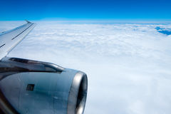 View from an airplane flying in the clouds Royalty Free Stock Photography