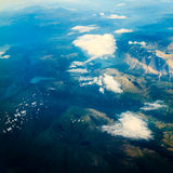 View from airplane flying over Norway. Royalty Free Stock Image