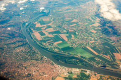 View from airplane on ground with fields, forest and rivers Stock Images