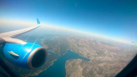 View from the airplane on the land and the sea. HD stock video footage