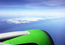 View from the airplane. View of the mountains of Siberia and lake Baikal from the airplane, in the foreground can be seen nozzle plane Royalty Free Stock Photo