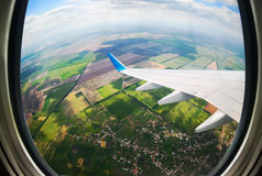 View through airplane porthole Stock Photo