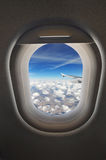 View from the airplane window. Cloudscape seen through an airplane window from the passenger seat Stock Images