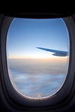 View from airplane window. View from plane window with beginning of sunrise and jet wing Royalty Free Stock Image