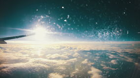 View from an Airplane Window above the Clouds on Sun Background stock footage