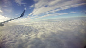 View from an Airplane Window above the Clouds stock video footage