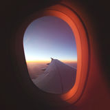 View From Airplane Window at Beautiful Sunrise. Luxery Travel Plane Concept. View From Airplane Window at Beautiful Sunrise. Luxery Travel Plane Concept Image Stock Photos