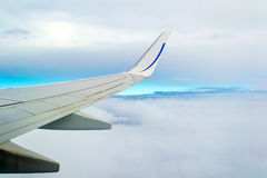 View from airplane window with blue sky Stock Photo