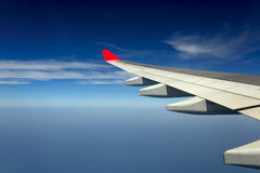 View from airplane window with blue sky Royalty Free Stock Photos