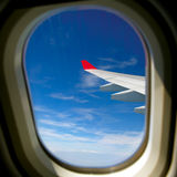 View from airplane window with blue sky. And white clouds Stock Images