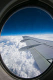 View from airplane window with blue sky and white clouds Stock Photography