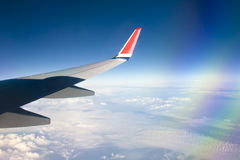 View from airplane window with blue sky and white clouds. Royalty Free Stock Images