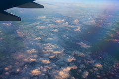 View from airplane window with blue sky and white clouds. Royalty Free Stock Photography