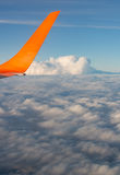 View from airplane window at the clouds Stock Images