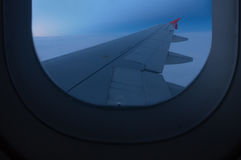 View through airplane window. During flight over clouds Royalty Free Stock Photography