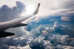 View from Airplane window fly over Cumulonimbus cloud bird eye v Stock Images