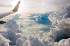 View from Airplane window fly over Cumulonimbus cloud bird eye v Stock Photo