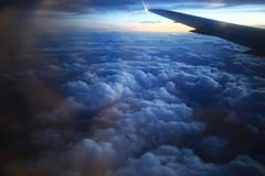 View of the airplane window at the horizon and clouds. View from the bird's-eye view of the airplane window at the horizon and clouds Stock Photo