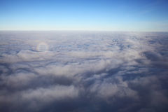 View of the airplane window at the horizon and clouds. View from the bird's-eye view of the airplane window at the horizon and clouds Stock Image