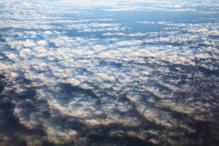 View of the airplane window at the horizon and clouds. View from the bird's-eye view of the airplane window at the horizon and clouds Royalty Free Stock Images