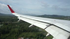 View from the airplane window landing at Phuket Airport, Thailand stock video