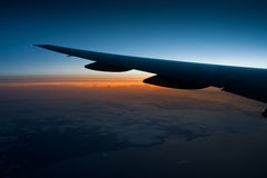View from airplane window at night. Amazing view from airplane at flight in the night sky Stock Image