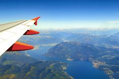 View from airplane window on the sea and mountains. Flight and journey to destination.Concept of airplane travel stock image