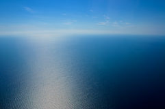 View from airplane window. The sea and the sky Royalty Free Stock Images