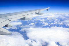 View from airplane window. View at the sky and airplain wing from airplane window Royalty Free Stock Photography