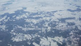 View from the airplane window on snowy winter fields of Wroclaw stock video