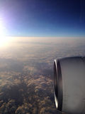 View from airplane window to airscrew during sunrise Royalty Free Stock Photo