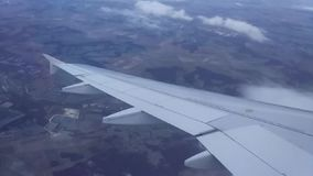 View from airplane window to the wing of an Airbus plane. Gradually descending to land in Paris, airport Charles de Gaulle stock footage
