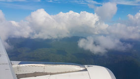 View from airplane window, Top view from airplane, Clouds on the sky and view from airplane window Stock Photo