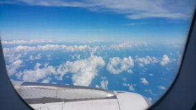 View from airplane window, Top view from airplane, Clouds on the sky and view from airplane window Stock Photography