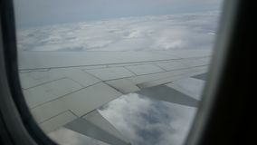 View airplane window. Traveling by air above clouds. View through an airplane window stock video