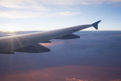 View of airplane wing above beautiful cloud at sunbeam and sunse. T.Travel and transportation concept Stock Images