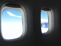 The view from the airplane on the wing, flying over the clouds. The concept of traveling by plane Royalty Free Stock Photography