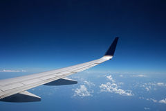 View of an Airplane Wing at High Altitude Stock Photo