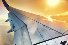 View of airplane wing through the window. Travel concept Royalty Free Stock Images