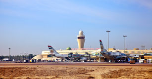 View on airplanes and terminal of Abu Dhabi Stock Image